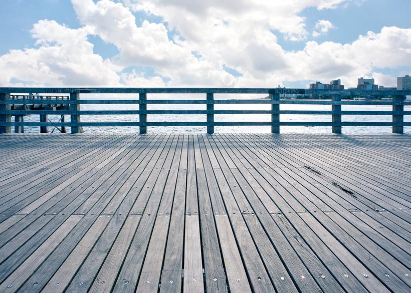 Empty pier at Coney Island beach, New York City.
